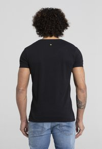 Liger - LIMITED TO 360 PIECES - ERYC WHY - ROTTERDAM - Print T-shirt - black - 2