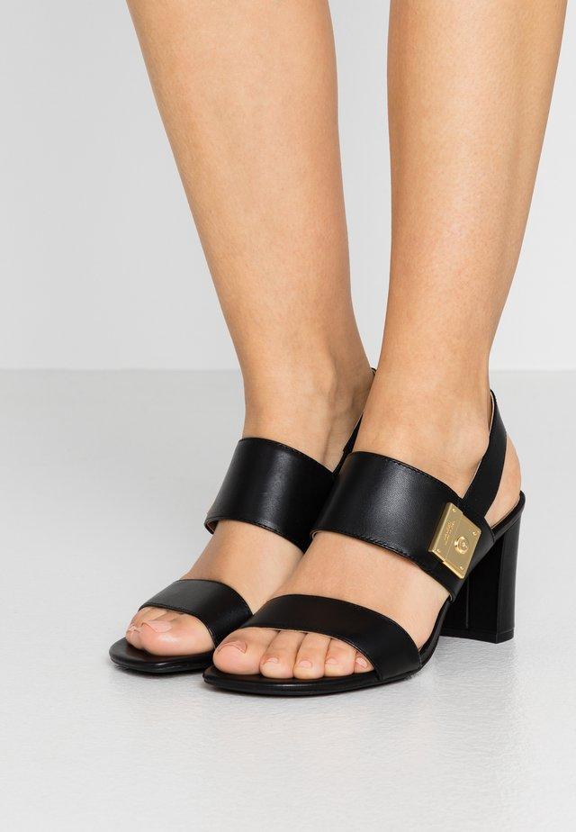 BRAIDAN - Sandaalit nilkkaremmillä - black