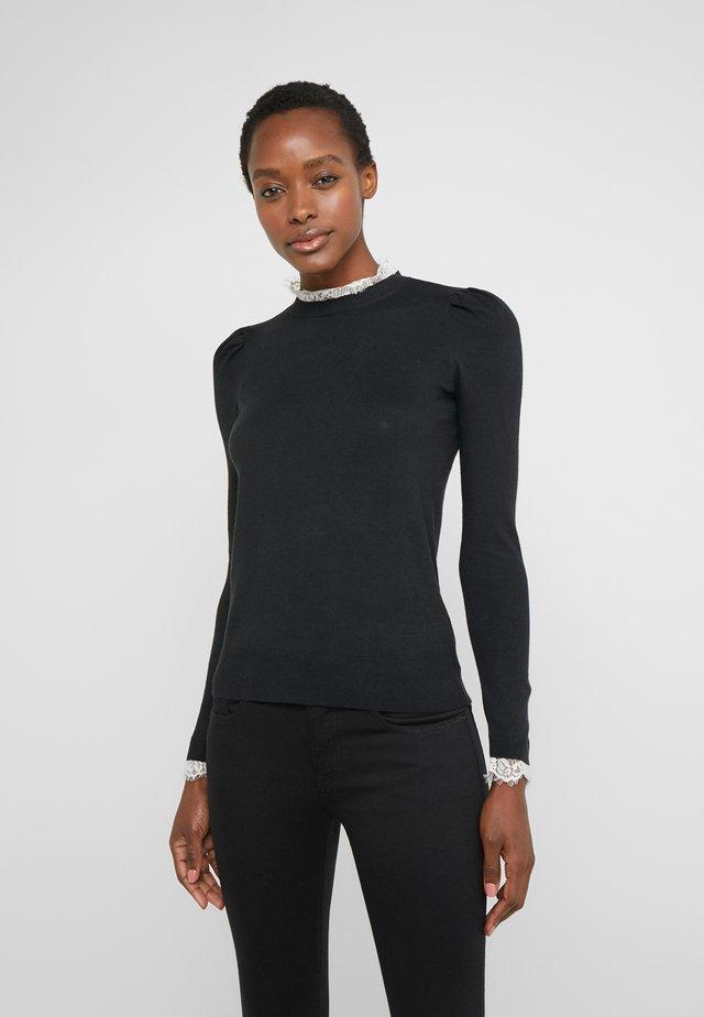 Stickad tröja - polo black
