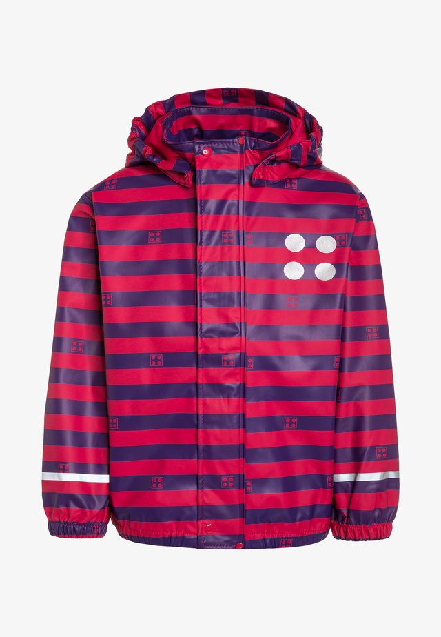JAMAICA - Waterproof jacket - red