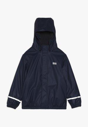 JORDAN RAIN JACKET - Waterproof jacket - dark navy