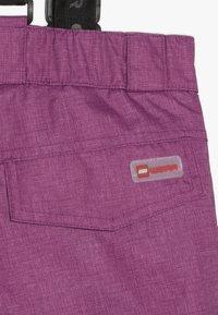 LEGO Wear - SKI PANTS - Zimní kalhoty - light purple - 6