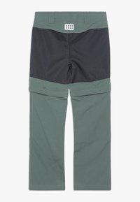 LEGO Wear - WEATHER PANTS - Outdoorové kalhoty - dark green - 1