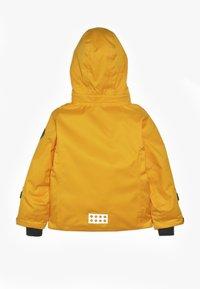 LEGO Wear - JOSEFINE JACKET - Lyžařská bunda - light orange - 1