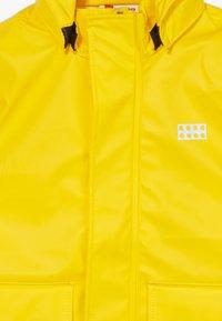 LEGO Wear - LWJULIO RAIN - Waterproof jacket - dark yellow - 2