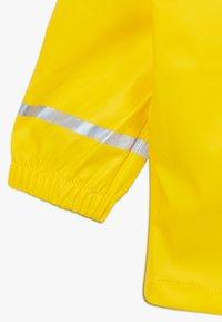 LEGO Wear - LWJULIO RAIN - Waterproof jacket - dark yellow - 4