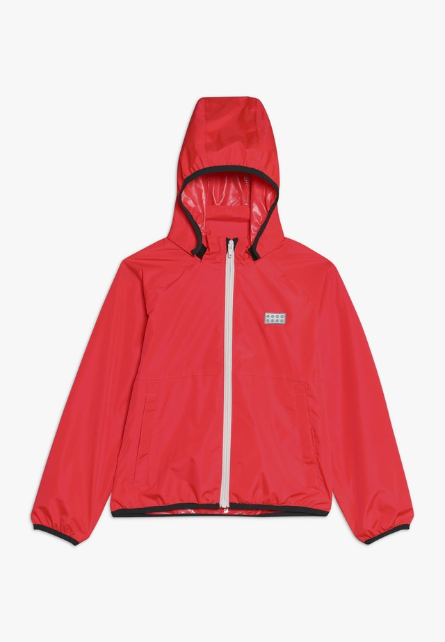 JOSHUA JACKET PACKABLE - Hardshell jacket - coral red