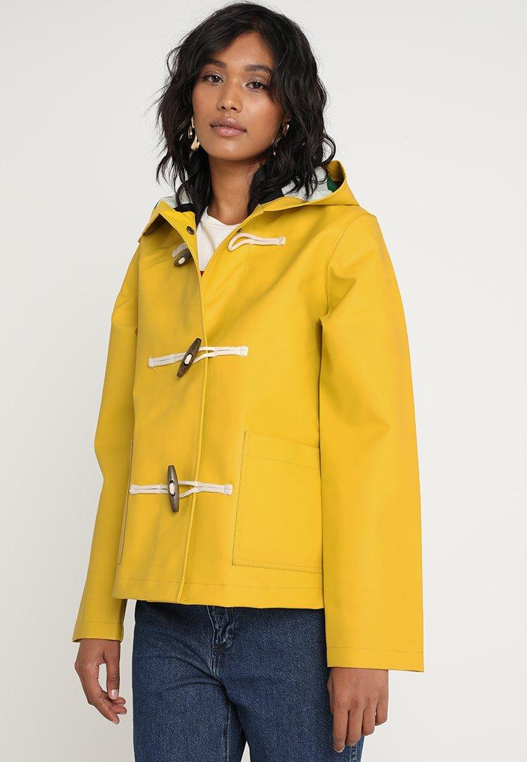 Louche - BENNY - Regenjas - yellow