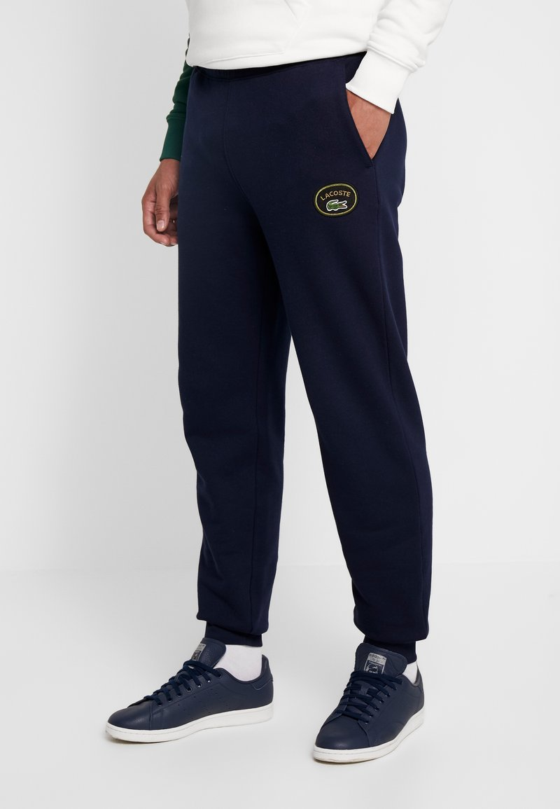 Lacoste LIVE - Tracksuit bottoms - marine