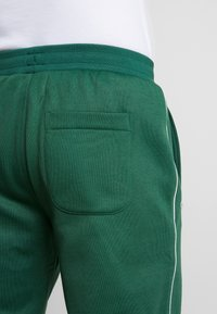 Lacoste LIVE - HH0604-00 - Tracksuit bottoms - green - 7