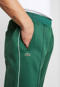 Lacoste LIVE - HH0604-00 - Tracksuit bottoms - green - 4
