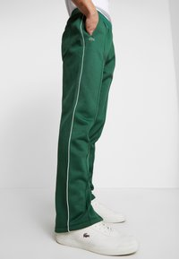 Lacoste LIVE - HH0604-00 - Tracksuit bottoms - green - 5