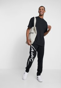 Lacoste LIVE - Pantalon de survêtement - black/white - 1
