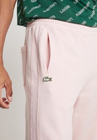 Lacoste LIVE - Tracksuit bottoms - lychee - 3