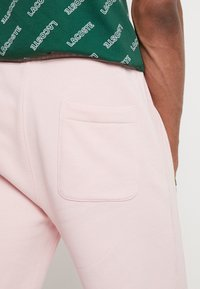 Lacoste LIVE - Tracksuit bottoms - lychee - 5