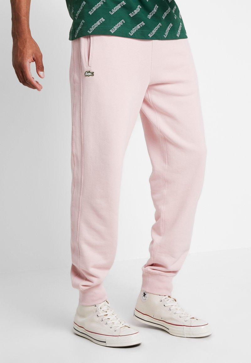 Lacoste LIVE - Tracksuit bottoms - lychee