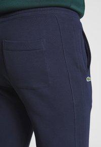 Lacoste LIVE - Tracksuit bottoms - navy blue - 5