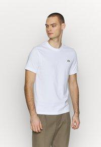 Lacoste LIVE - T-shirt - bas - white - 0