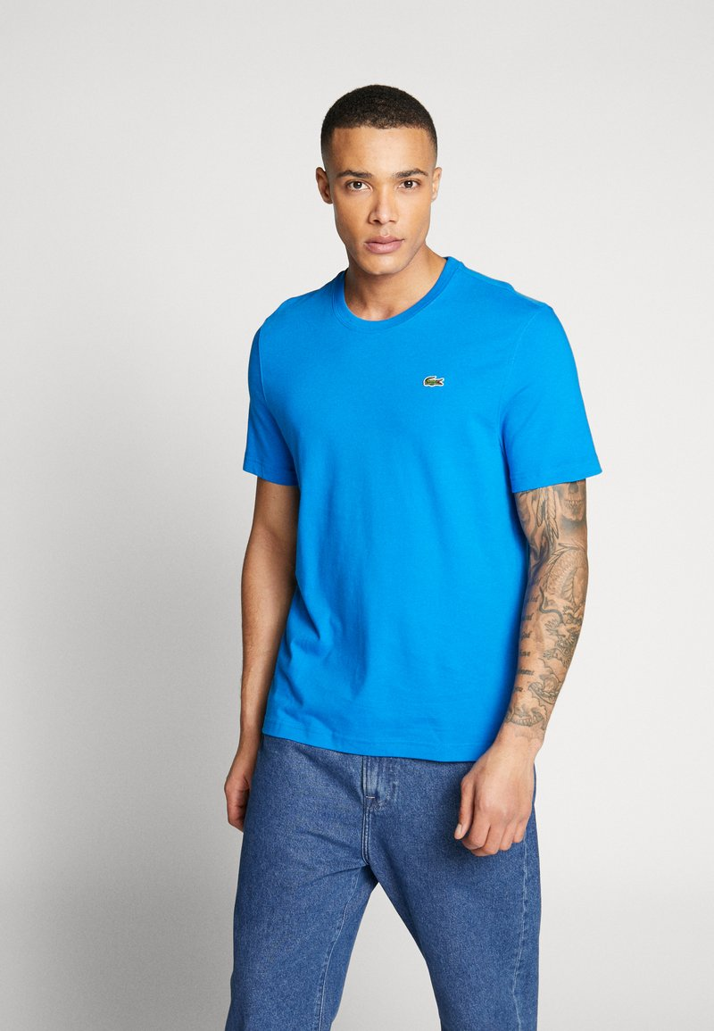 Lacoste LIVE - T-Shirt print - nattier blue/white