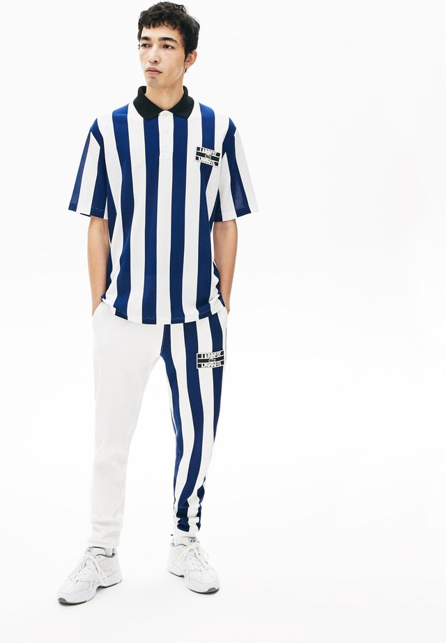 Poloshirt - blanc / bleu marine / noir