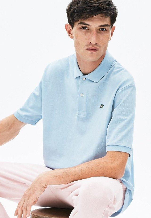 PH8027-00 - Poloshirt - light blue