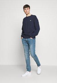 Lacoste LIVE - Sweatshirt - navy blue - 1