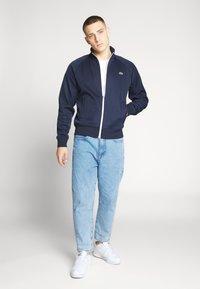 Lacoste LIVE - Sportovní bunda - navy blue/white - 1