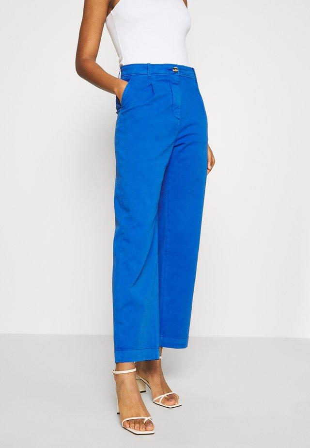 POISON - Pantalon classique - blue