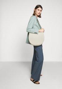 Loeffler Randall - CAROLINE TWISTED RING - Handbag - cream - 1