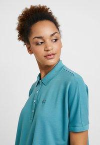 Lacoste - T-shirt imprimé - tide blue - 4