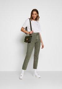 Lacoste - DAMEN RUNDHALS - Basic T-shirt - white - 1