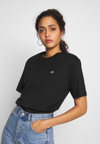 Lacoste - DAMEN RUNDHALS - T-shirt basique - black - 0