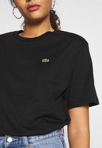 Lacoste - DAMEN RUNDHALS - T-shirt basique - black - 4