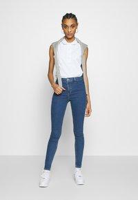 Lacoste - SLEEVELESS BASIC SLIM FIT - Polo shirt - white - 1