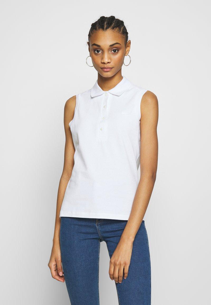 Lacoste - SLEEVELESS BASIC SLIM FIT - Polo shirt - white