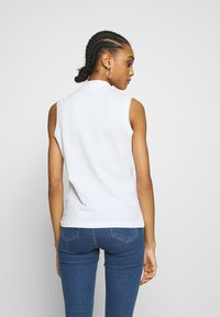 Lacoste - SLEEVELESS BASIC SLIM FIT - Polo shirt - white - 2