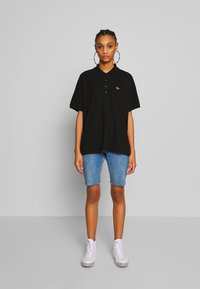 Lacoste - Polo shirt - black - 1
