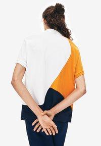 Lacoste - Polo - navy blue/white/orange - 1