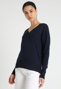 Lacoste - V NECK - Jersey de punto - navy blue - 0