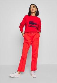 Lacoste - Sweater - corrida/navy blue - 1