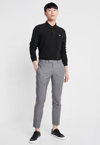 Lacoste - CLASSIC FIT - Polo shirt - black - 1