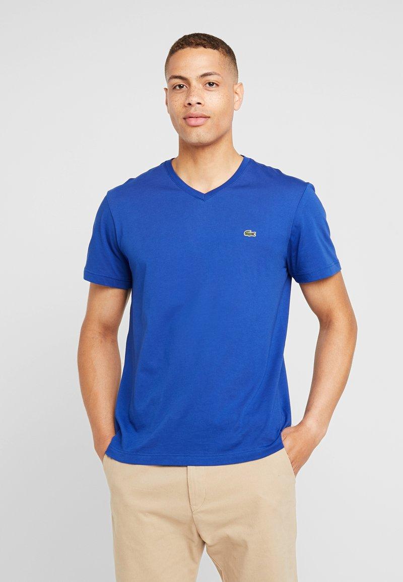 Lacoste - T-shirt - bas - capitaine