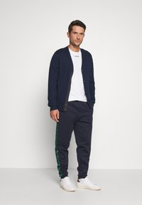 Lacoste - Tracksuit bottoms - dark navy blue/green - 1