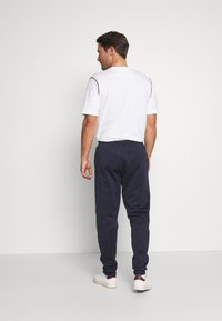 Lacoste - Tracksuit bottoms - dark navy blue/green - 2