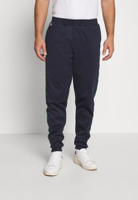 Lacoste - Tracksuit bottoms - dark navy blue/green - 0
