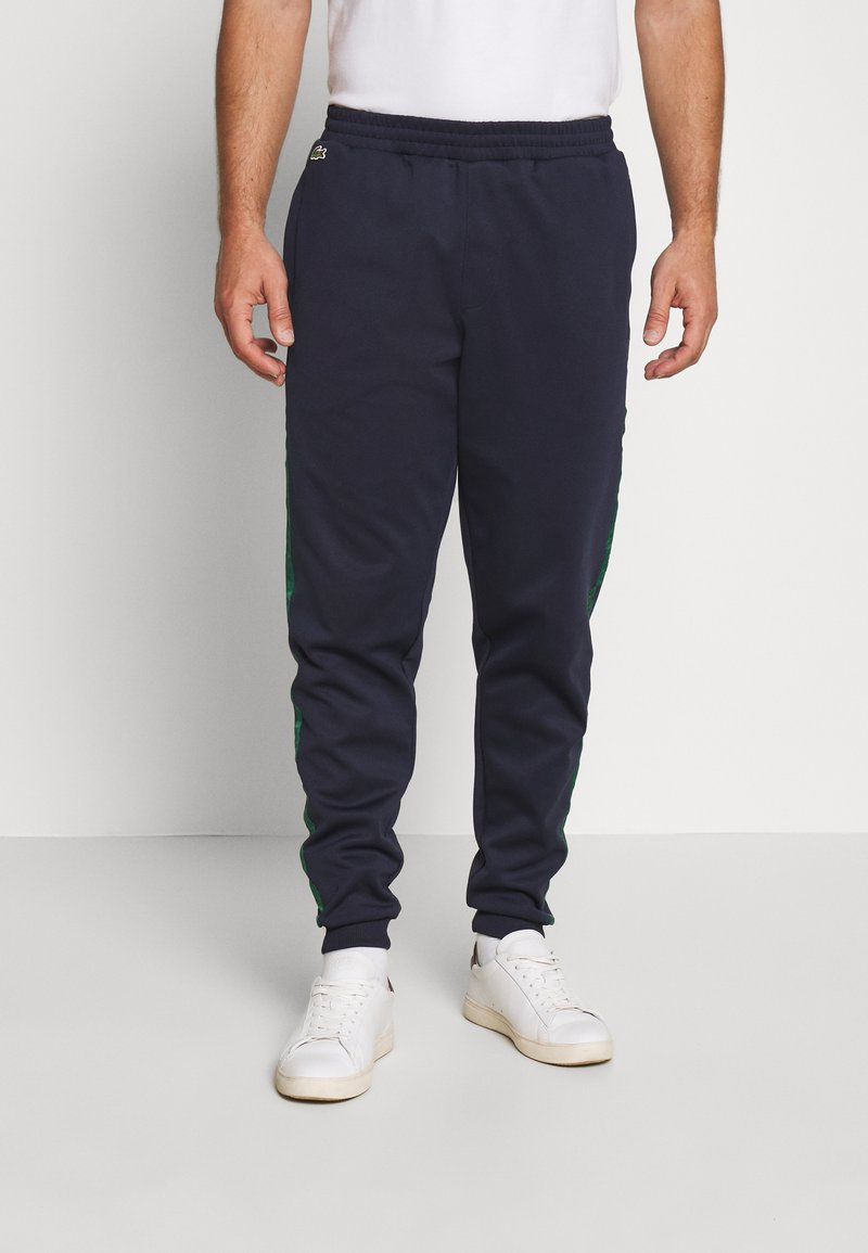 Lacoste - Tracksuit bottoms - dark navy blue/green