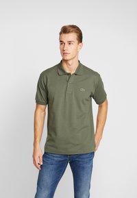 Lacoste - Polo shirt - aucuba - 0
