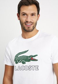 Lacoste - T-shirt con stampa - white - 4