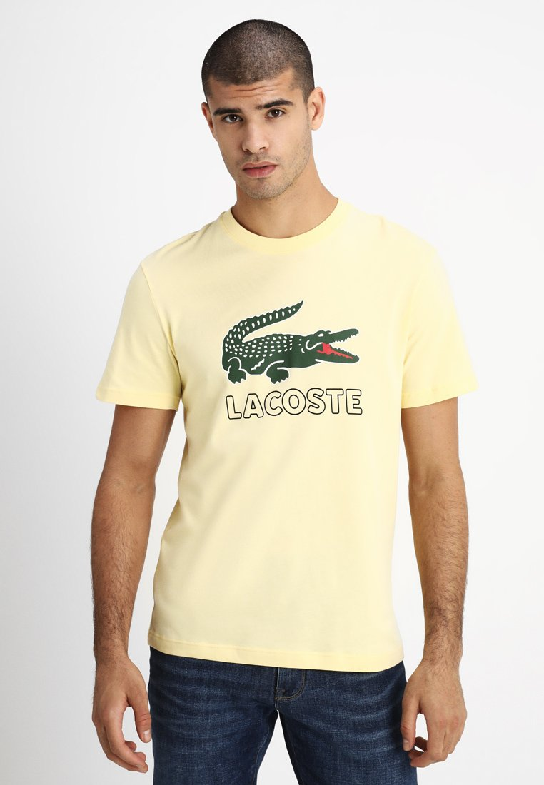 Lacoste - T-shirt med print - napolitan yellow