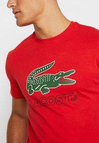 Lacoste - T-shirt z nadrukiem - clusi chine - 4